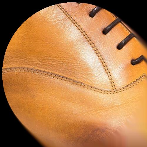 detail of yellow brown leather shoe - Guidomaggi Switzerland